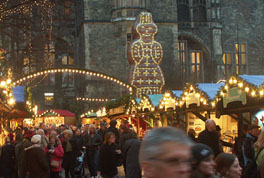 Aachen Christmas Market with big Aachener Printe a spicy cake